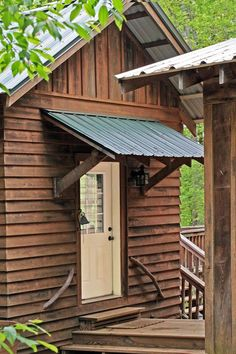 Roofing & awning idea for cottage. Also like the tree branch handholds. North Georgia log cabin, mud room entrance. Clark & Zook Architects. (Bell :-))
