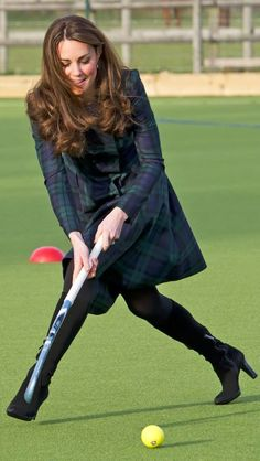 She's game! Heels proved no obstacle for Kate as she took to the hockey pitch wearing knee-high boots.
