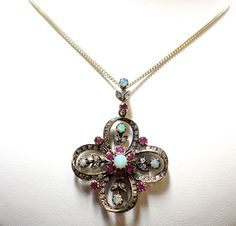 Jewellery 9ct Yellow Gold Opal, Ruby and 0.57ct Diamond Pendant Vintage Antique Reproduction £1195.00 Contact us at www.facebook.com/ellisondavisjewellery for more information