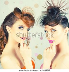 Surprised Gorgeous Twins Girls looking at camera with Fashion Hairstyle for a Party at Night Club. Identical. Glamoor makeup. Portret. Happy sisters. Twin. Disco, retro party