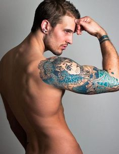 Lion Wave Half Sleeve Tattoo. who cares aboutthe tattoo.... Mmmm =)