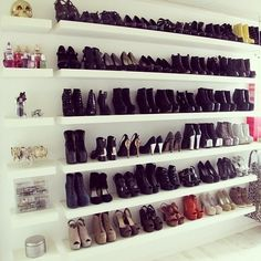 Brilliant. What every #shoeobsessed girl should have! Install shelving along a blank wall in your apt! Not one for power tools? Line up bookshelves instead. #bookshelvessolutions #shoestoragesolutions