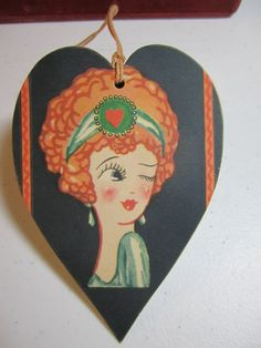 Darling unused 1920's  jazz age Art Deco Heart shaped bridge tally card with winking red headed flapper girl