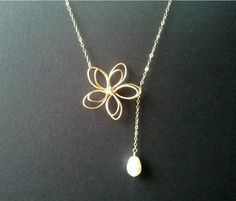 OOOOOooo cute!!   Flower with White Pearl Lariat Necklace by LaLaCrystal on Etsy