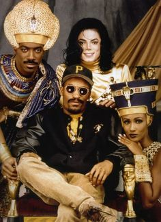 """Eddie, director John Singleton, Michael Jackson, and Iman in costume for the music video """"Remember the Time""""."""