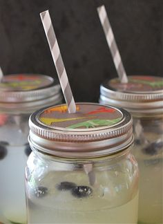 mason jar sippy cup, parchment and scrapbook paper for lid