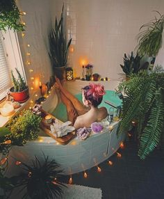 Tub space inspo; plants, tea lights, crystals, aromatherapy, books, Himalayan salt lamps