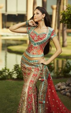 red, gold and teal lehenga