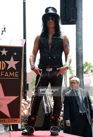 Slash. Born Saul Hudson 23.July 1965 in Hampstead, London. UK