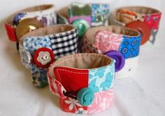 fabric braclets #http://jchandmade.typepad.com/jc_handmade/2009/02/miy-mama-chic-wrist-cuff.html Toby would love these in Pirate fabric