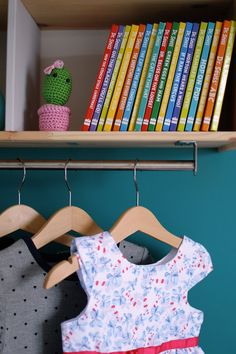 Adding a hanging rail allows for a dress up space in a toddler bedroom