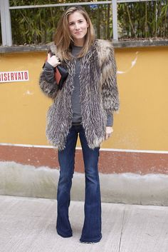 This outfit's enough to make us wish for cold weather - the flare jeans, the fur jacket...