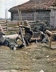 German mortar crew. *Note the machine gun support team in the background.