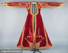 Ottoman Style Velvet Coat, Red velvet w/ metallic gold soutache in ornate patterns, 5 gold thread wrapped buttons at CF, 4 w/ small coral bead at tip, front panels & sleeves lined in red & white woven cotton, back lining of yellow leaf printed on blue cotton, Late 19th C