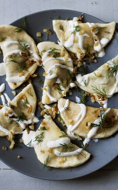 Two varieties of vegetarian pierogi - mushroom and sauerkraut or cheese and potato lashed with sour cream walnuts and dill.