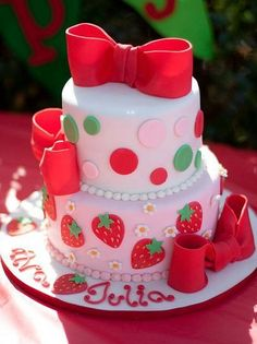 Google Image Result for http://data.whicdn.com/images/15541037/Two+tier+light+pink+round+cake+with+red+bowties+and+strawberry+art_large.JPG