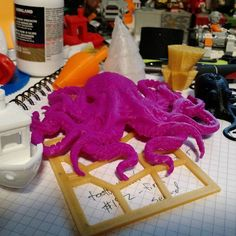 """3dprinted stuff everywhere!! Going to need a bigger desk soon! #3dprinting #3dbenchy #octopus"""