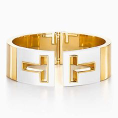 Tiffany T cutout hinged cuff in 18k gold with white ceramic, medium.