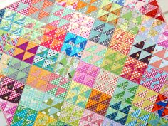 Half square triangle quilt. So bright and fun!