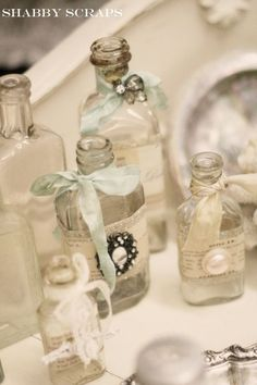 I've ways thought it would be awesome to collect jars and bottles to decorate a table with, with ribbons and decoratives, and have slips of parchment paper that the guests can write notes on to us and we read the notes after the wedding.