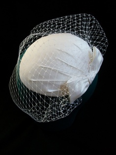 Bridal hat with a birdcage veil