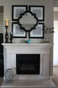 Black spray painted frames above the fireplace hold scrapbook paper in a pattern Frieling loves. For a 3-D effect, she installed the mirror with L brackets. by: Dana Frieling