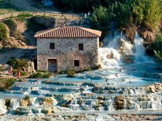 Bathe in the thermal waters in Cascate del Mulino, Saturnia, Italy