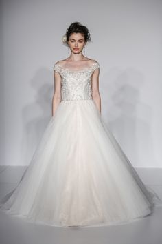 Gorgeous ball gown wedding dress with illusion off-the-shoulder neckline and dramatic illusion lace back. Montgomery from Maggie Sottero's Aracella Collection.