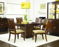 """Skyline Pedestal Dining Room - SKU: 9903159    Table: 54"""" W x 54"""" D x 30"""" H   Wood Back Side Chair:  20"""" W x 25"""" D x 41"""" H    Skyline appeals to anyone looking for smart, fresh, practical design. Rich cherry veneers show off the deep brown finish and simple yet sophisticated shapes give the collection a fresh appeal. This combination is classic transitional design with style and substance - perfect for today's homes."""