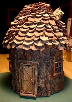 fairy house from oatmeal container, bark, pinecones | Add a tiny wreath on the door for Christmas