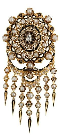 A Magnificent & Larger Scale Victorian Pearl & Diamond Brooch, Designed as a sunburst with fringes lavishly decorated throughout with pearls, diamonds totaling approximately 6.75 carats, and black enamel. The articulated fringe section is connected via a system of hooks and can be removed to wear the sunburst section by itself. 18 karat France 1860s.