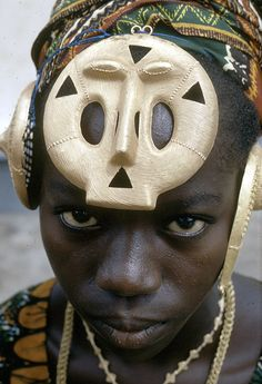 Katherine Ake Agouable wearing traditional gold ornaments, Anne Village, Ivory Coast.