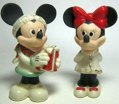 A charming salt and pepper shaker set to grace your holiday table this season: Mickey Mouse giving Minnie Mouse her Christmas present. (by Lenox)