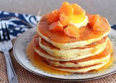 Serve these pillowy soft homemade buttermilk pancakes from scratch drizzled with homemade orange syrup for breakfast. Homemade Buttermilk Pancakes, Homemade Breakfast, Breakfast Snacks, Breakfast Cake, Breakfast Dishes, Breakfast Recipes, Brunch Recipes, Pancakes From Scratch, How To Make Pancakes