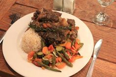 West Coast cuisine at its best! Traditional Oxtail served with rice and vegetables of the day.