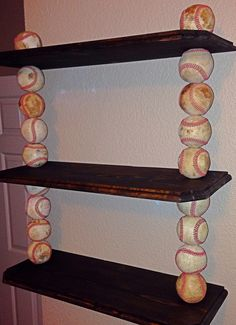 Custom, made to order baseball shelves. All shelves are made from real wood and real leather baseballs. They can made in any size and with your choice of color. You can also choose between new or used baseballs, depending on the look that you prefer. The most popular are the 2-tier and 3-tier wall shelves. It's a great way to display your players trophies, game balls, pictures, autographs and awards! Contact Mike Lewis at mike_craig_lewis@yahoo.com or 214-724-8315.