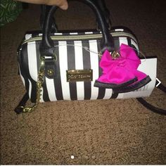 Betsey Johnson-mini cross body duffle Brand new, compact, black w/stripes, pink bow, black strap and handles, trademark Betsey lining.  *** bundle for a DISCOUNT!!! Reasonable offers welcomed!!! Betsey Johnson Bags Crossbody Bags