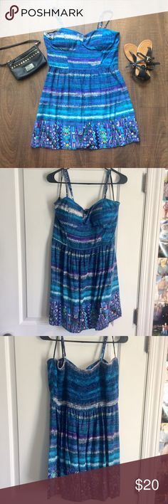 Blue Summer Dress This was given to me as a gift and only worn once. I absolutely love the colors and pattern, but it is too big for me. The material is light and perfect for summer! Love Reign Dresses