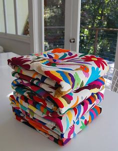 Hand-stitched quilts...coverlets from Mexico