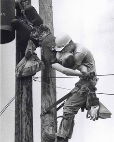 """The Kiss of Life"". This iconic photo shows a utility worker receiving mouth-to-mouth after being electrocuted. He survived. (1967)."