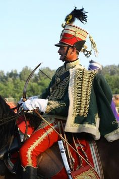 Huszár= hussar- refers to a number of types of light cavalry which originated in Hungary during the 15th century. The title and distinctive dress of these horsemen was subsequently widely adopted by light cavalry regiments in European and other armies. A number of armored or ceremonial mounted units in modern armies retain the designation of hussars.
