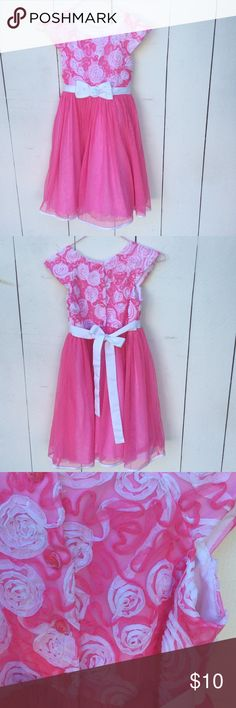 Pink party dress Such a fun dress in great condition! Beautiful rose that detail on the bodice and a full skirt with a petticoat attached.   Back button closure with a tie belt. 100% polyester. Fully lined. Hand wash, line dry. Jona Michelle Dresses Formal