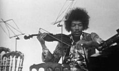 Jimi Hendrix playing the violin