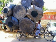 These containers spotted in Jaipur, India may be light on weight, but they certainly aren't light on volume! Photo by Don César Tricycle, Velo Cargo, Firewood, Transportation, The Incredibles, Canning, Crafts, Jaipur India, Barrels