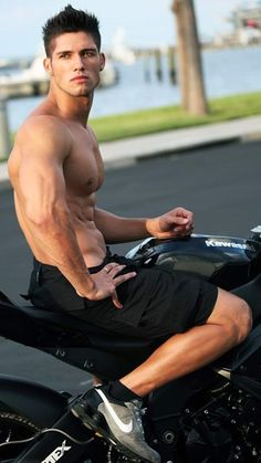 Shirtless muscle stud on his motorbike