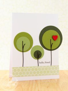 Use die cut or punched circles -- could use paint chips for this, too