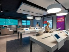 Digital Signage instead Prints - displays in the background (Photo: ARGOS)