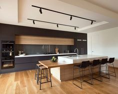 Interior, Cool American Oak With Clear Coat Finish Also Modern Kitchen Interior Plus Black Track Lighting As Well As Wall Colour Whisper White From Dulux Unique Laminate Flooring Barstools: Gorgeous Home Interior Ideas with Modern Design