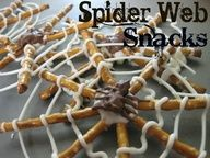 spiderman party food Spider Web pretzel snacks with a little white and milk melted choccy to hold it all together ! Kids can even decorated these ... Mums will need to clean up Im guessing - Thank goodnes for greaseproof baking paper !