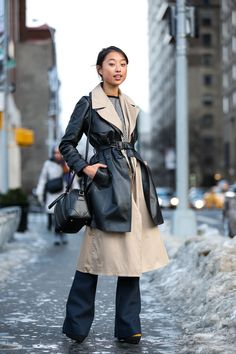 Below-Freezing NYC Street Style That's Still Fire #refinery29  http://www.refinery29.com/2015/02/82279/new-york-fashion-week-2015-street-style-pictures#slide-147  Margaret Zhang layers her trenches. Jonathan Simkhai dress.